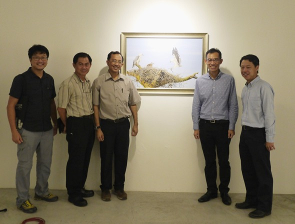 Visitors posing with CEO NParks and artist.